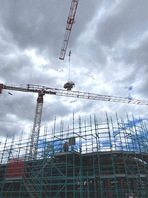 crane in compressor for electrode installation